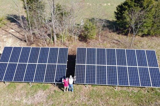 Bobby and Lori Fore waving, Solar Panel Array, Kentucky,