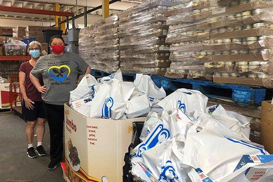 Facing Hunger Volunteers in warehouse